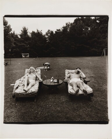 View 2. Thumbnail of Lot 9. DIANE ARBUS | 'A FAMILY ON THEIR LAWN ONE SUNDAY IN WESTCHESTER, N. Y.'.