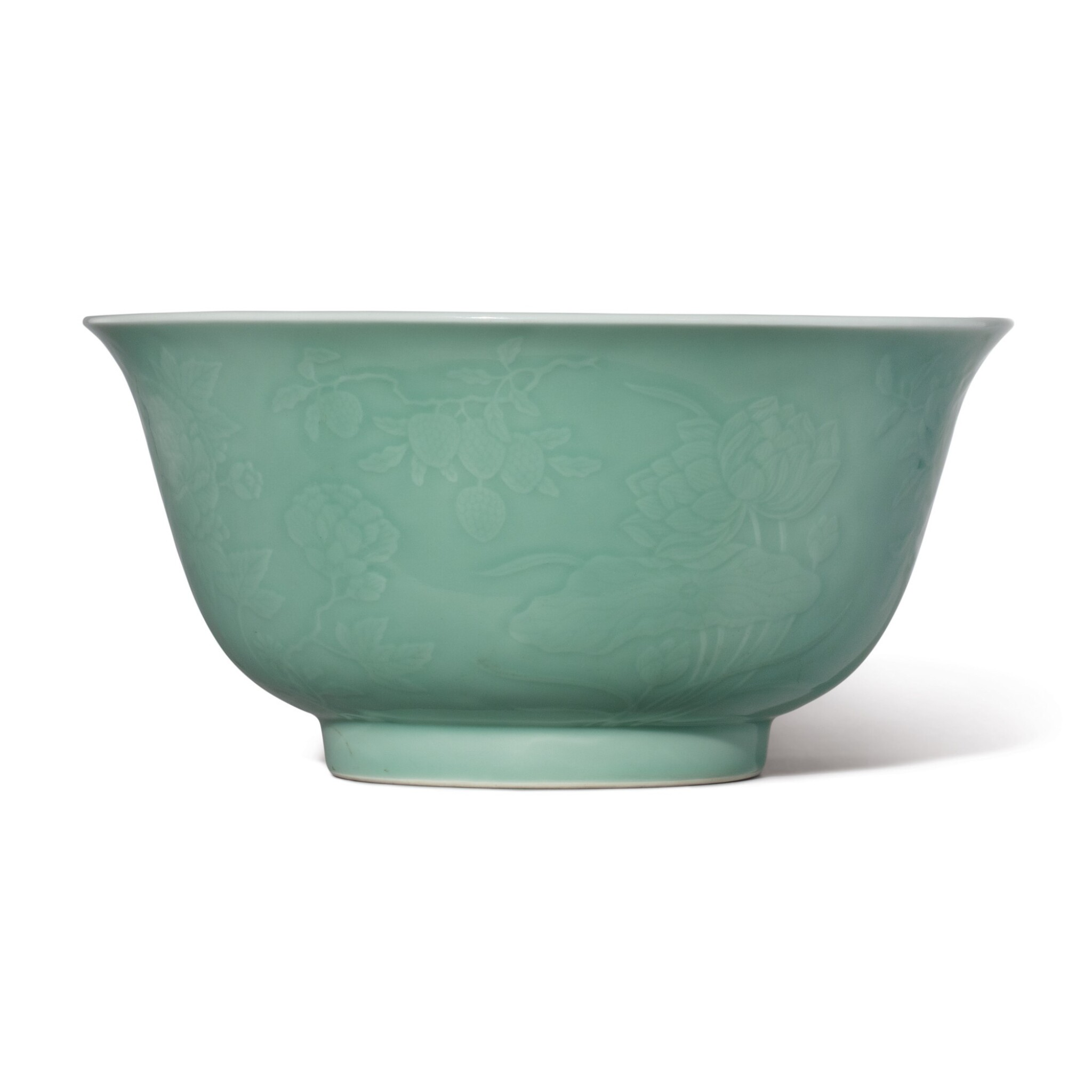 View full screen - View 1 of Lot 532. A FINE LARGE MOLDED CELADON-GLAZED BOWL,  QIANLONG SEAL MARK AND PERIOD.