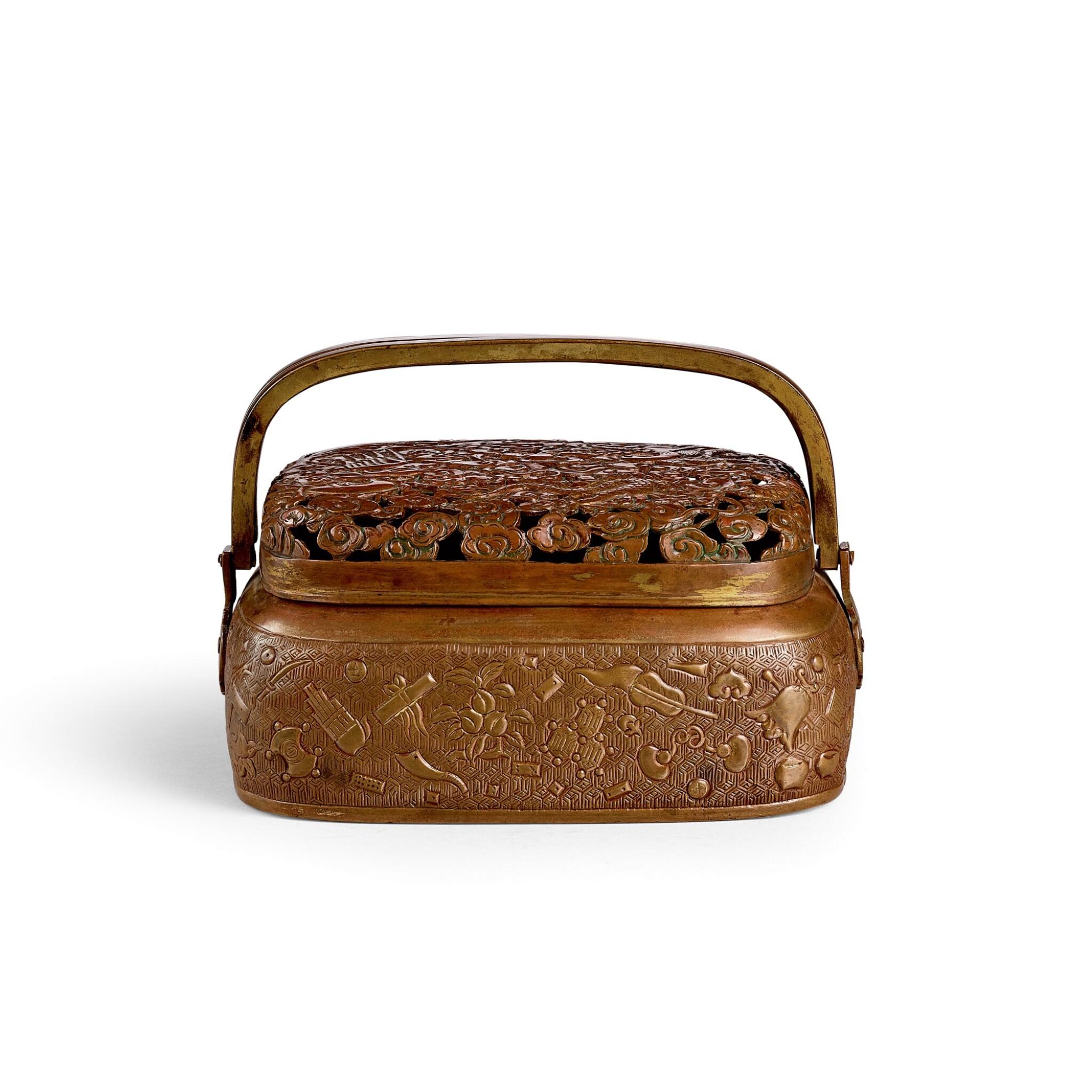 View full screen - View 1 of Lot 3677. A rare parcel-gilt copper alloy rectangular bronze handwarmer By Hu Wenming, Late Ming dynasty   明末 胡文明製局部鎏金銅鏤空祥雲龍鳳紋手爐 《胡文明製》款.