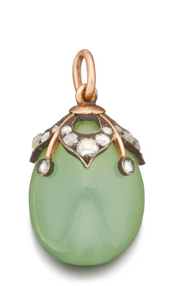 View 1. Thumbnail of Lot 46. A LARGE FABERGÉ JEWELED AND GOLD-MOUNTED BOWENITE EGG PENDANT, WORKMASTER MICHAEL PERCHIN, ST PETERSBURG, CIRCA 1890.