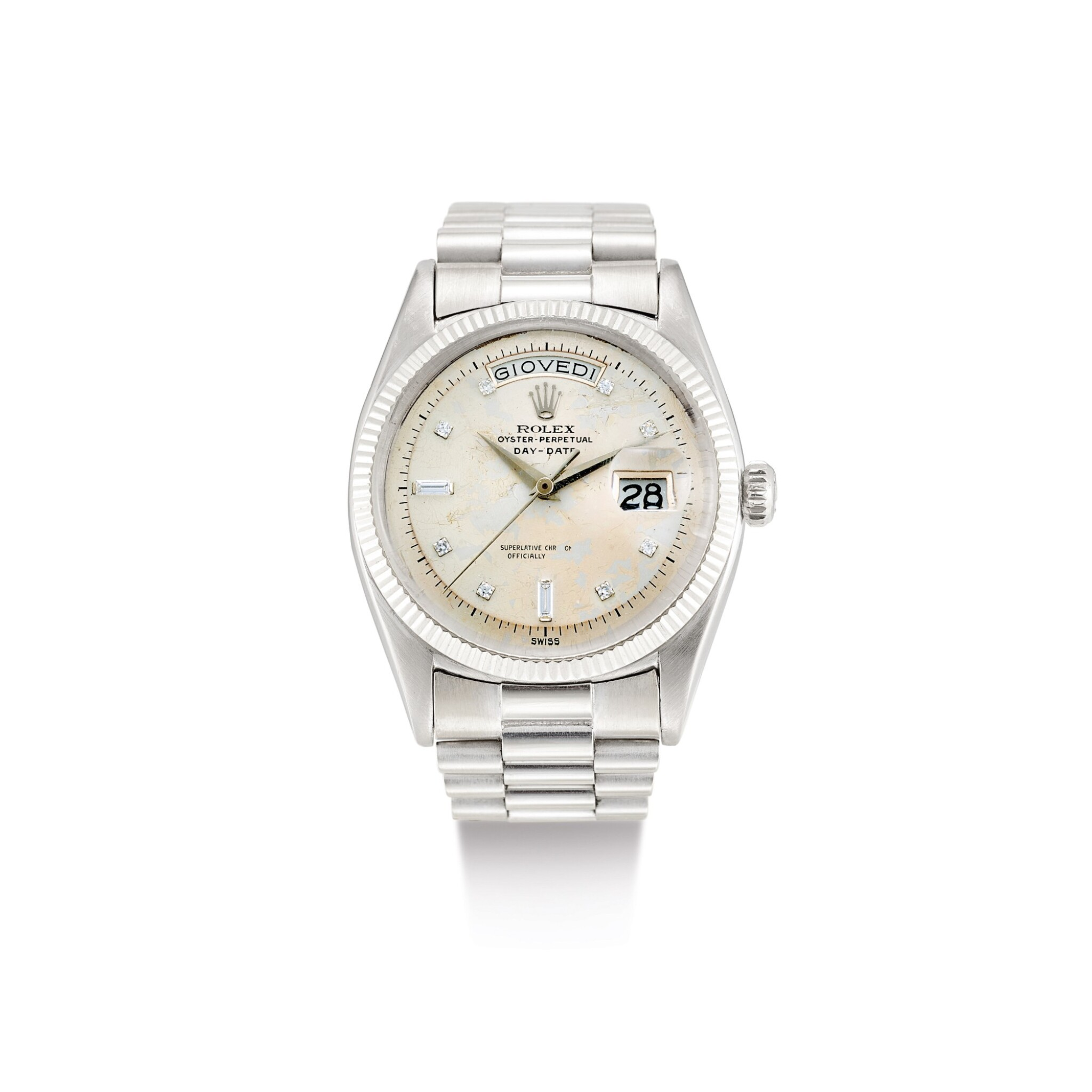 """View full screen - View 1 of Lot 2133. ROLEX   DAY-DATE, REFERENCE 6611B, A WHITE GOLD AND DIAMOND-SET WRISTWATCH WITH DAY, DATE AND BRACELET, CIRCA 1958   勞力士   """"Day-Date 型號6611B 白金鑲鑽石鏈帶腕錶,備日期及星期顯示,錶殼編號401552,約1958年製""""."""