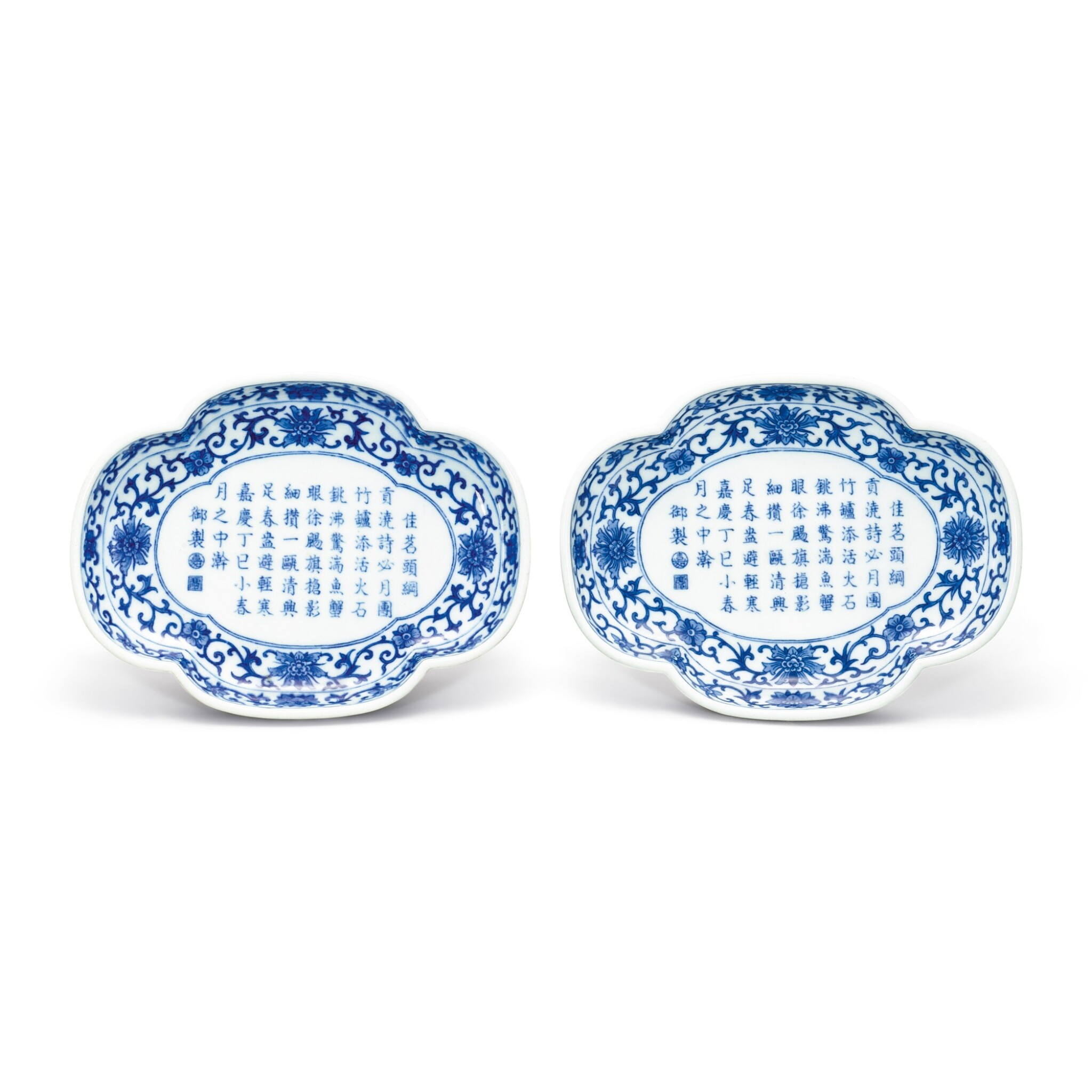 View 1 of Lot 105. A FINE PAIR OF INSCRIBED BLUE AND WHITE TEA TRAYS SEAL MARKS AND PERIOD OF JIAQING   清嘉慶 青花御題詩海棠式茶盤一對 《大清嘉慶年製》款.