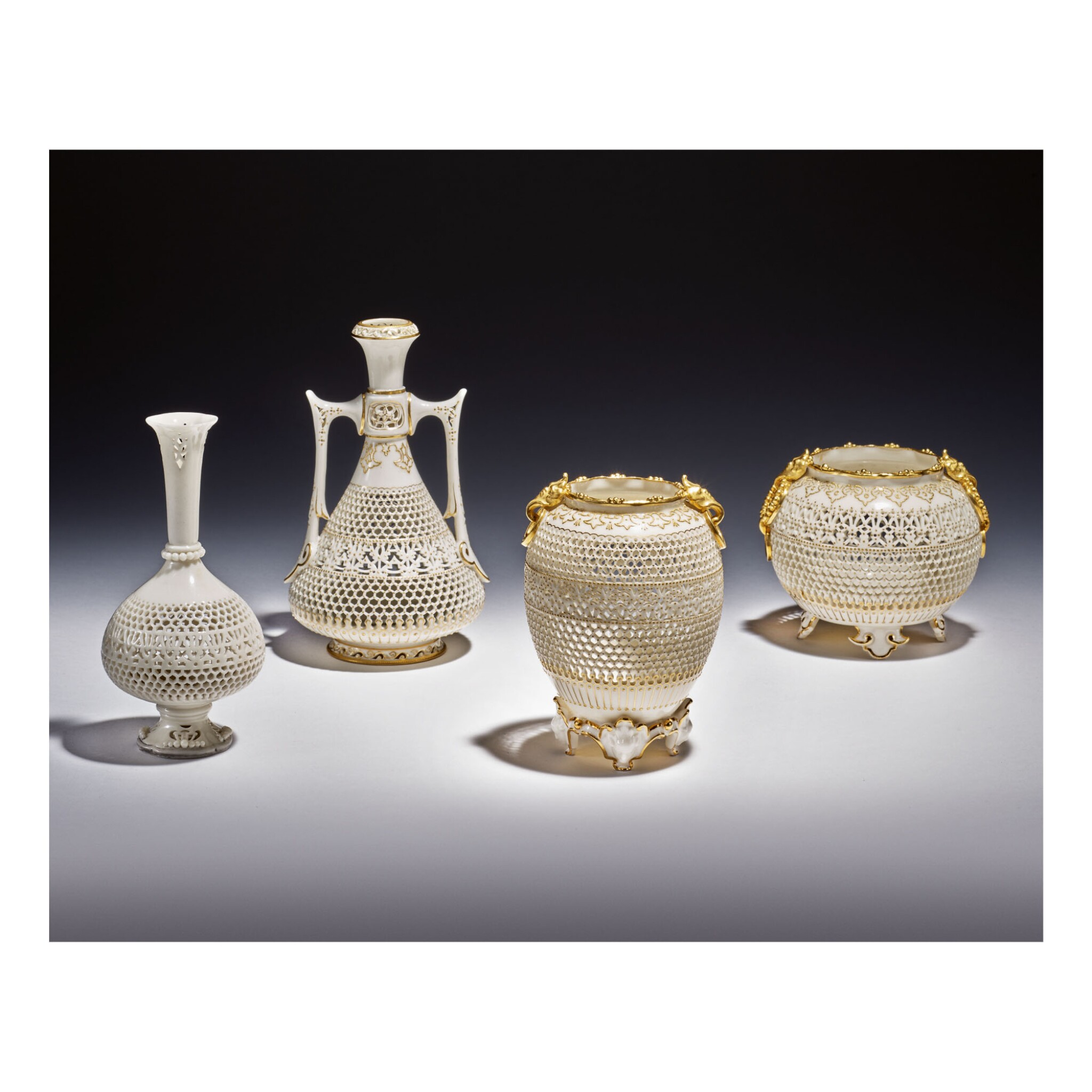 FOUR ROYAL WORCESTER RETICULATED PORCELAIN VASES BY GEORGE OWEN 1912, 1919, 1923 AND 1929
