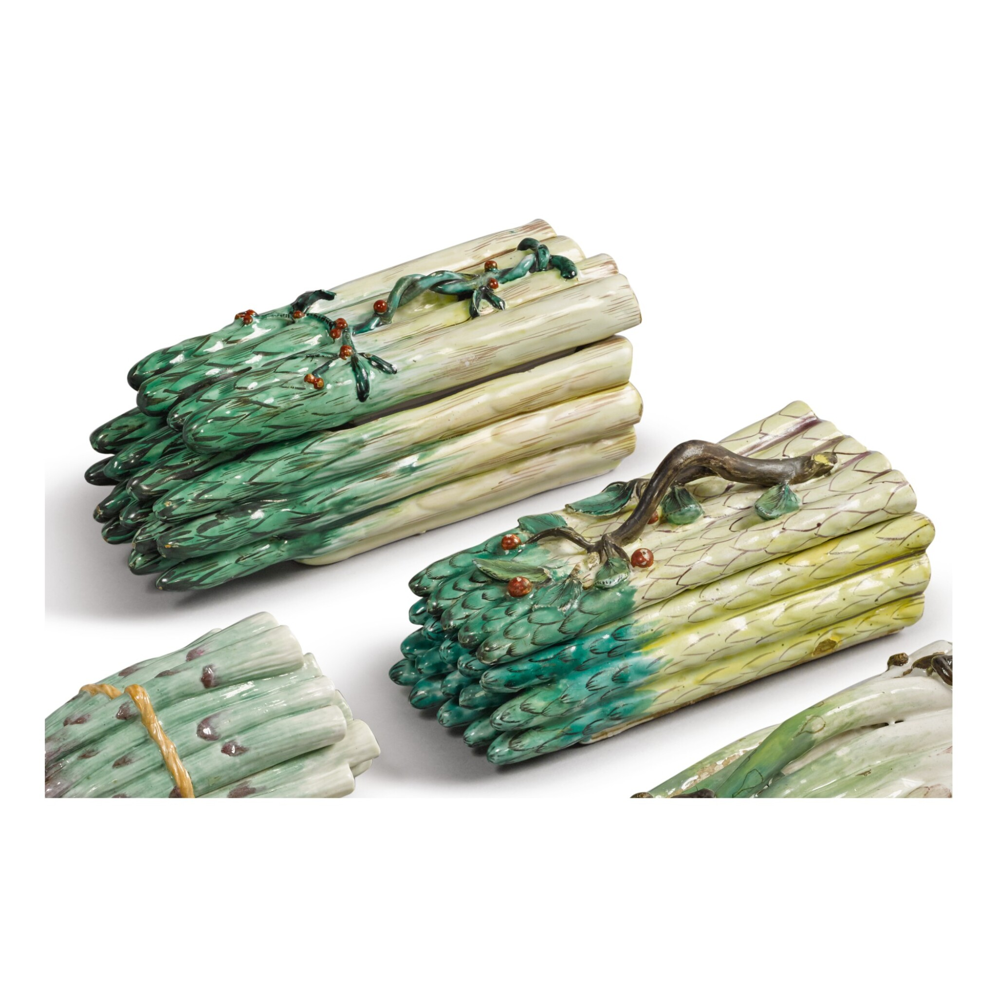 TWO CONTINENTAL FAIENCE ASPARAGUS BOXES AND COVERS, CIRCA 1770
