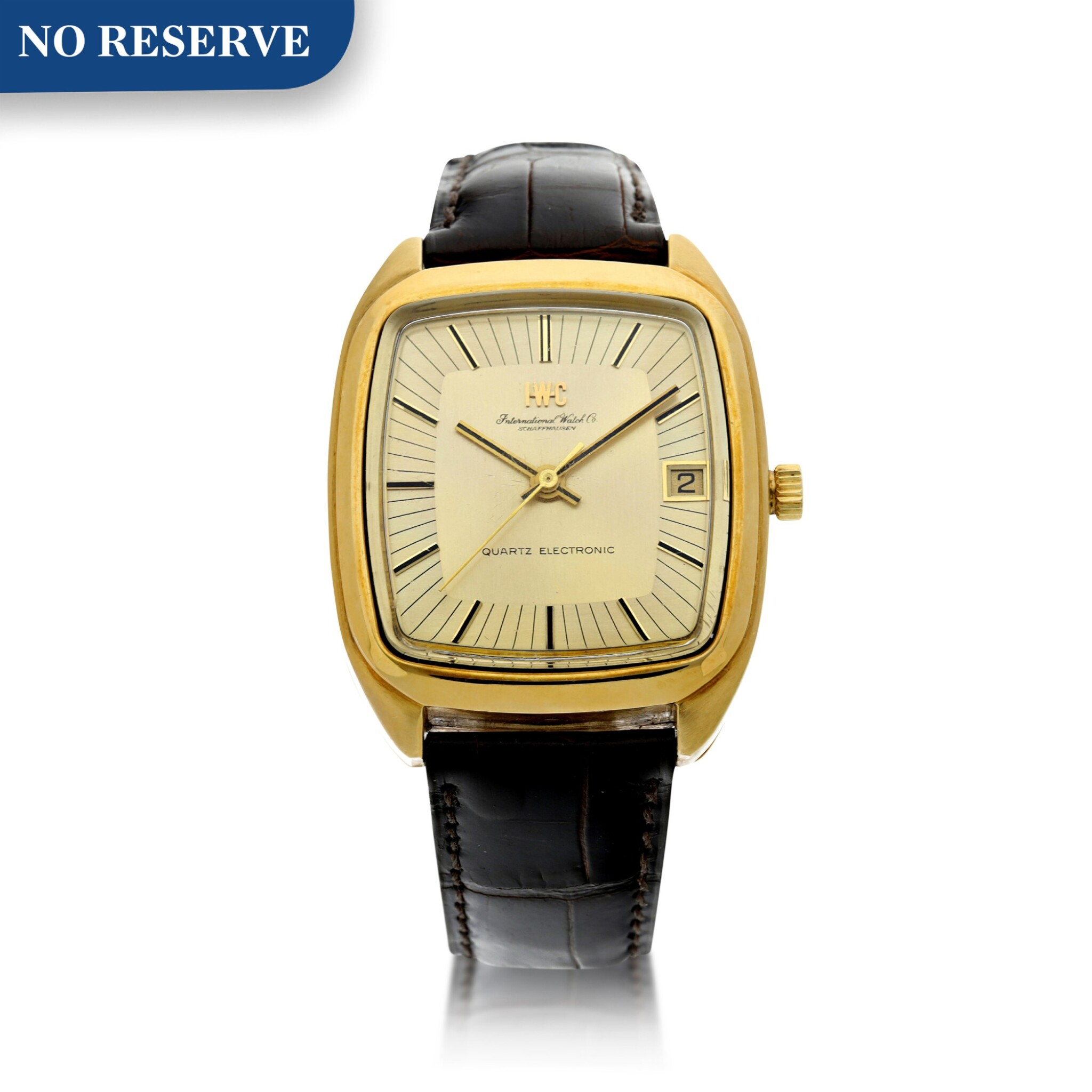 View full screen - View 1 of Lot 92. REFERENCE R3003 A YELLOW GOLD TONNEAU SHAPED WRISTWATCH WITH DATE, CIRCA 1970.