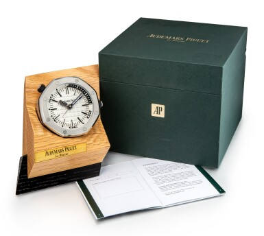 View 5. Thumbnail of Lot 108. AUDEMARS PIGUET   ROYAL OAK A STAINLESS STEEL ALARM DESK CLOCK WITH WOODEN STAND, CIRCA 2016.