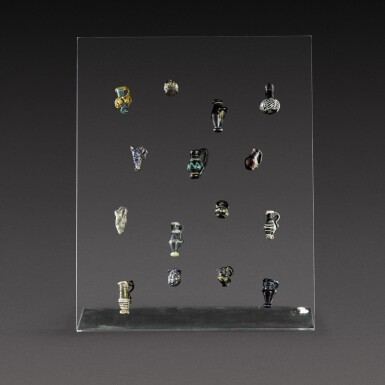 View 1. Thumbnail of Lot 11. A Group of Fifteen Roman Miniature Glass Vessels, circa 1st/4th century A.D..