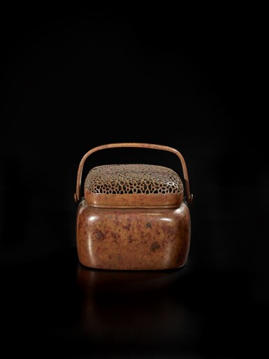 View 2. Thumbnail of Lot 126. A bronze hand warmer and cover, signed Zhang Mingqi, 17th century | 十七世紀 銅透空錦紋蓋手爐 《張鳴岐製》款.