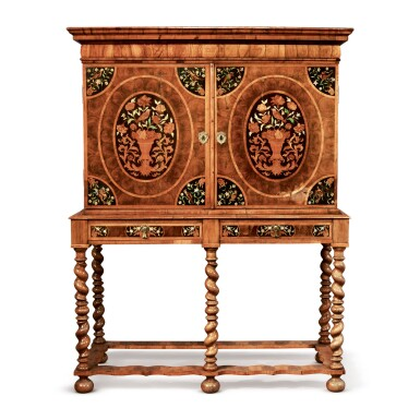 View 1. Thumbnail of Lot 524. A WILLIAM AND MARY OYSTER-VENEERED WALNUT AND FLORAL MARQUETRY CABINET ON STAND, LATE 17TH CENTURY.
