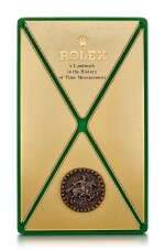 ROLEX | A GILT BRASS AND LEATHER DISPLAY, CIRCA 1970