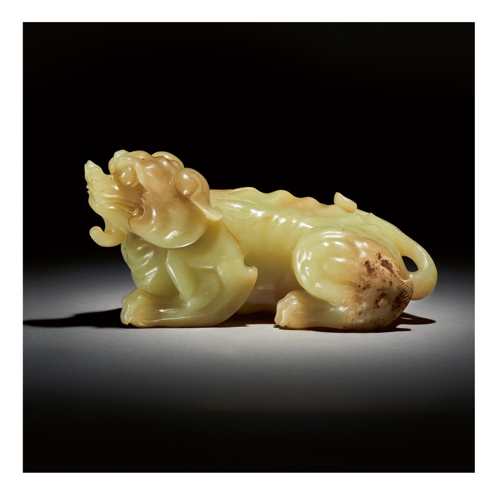View full screen - View 1 of Lot 227.  A LARGE YELLOW AND RUSSET JADE CARVING OF A MYTHICAL BEAST,  QING DYNASTY, QIANLONG PERIOD.