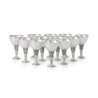 A SET OF TWELVE SMALL DANISH SILVER GOBLETS, NO. 309B, DESIGNED BY JOHAN ROHDE, GEORG JENSEN SILVERSMITHY, COPENHAGEN, DATED 1928