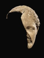 A FRAGMENTARY ROMAN MARBLE HEAD OF THE ARTEMIS OF GABII, CIRCA 1ST CENTURY A.D.
