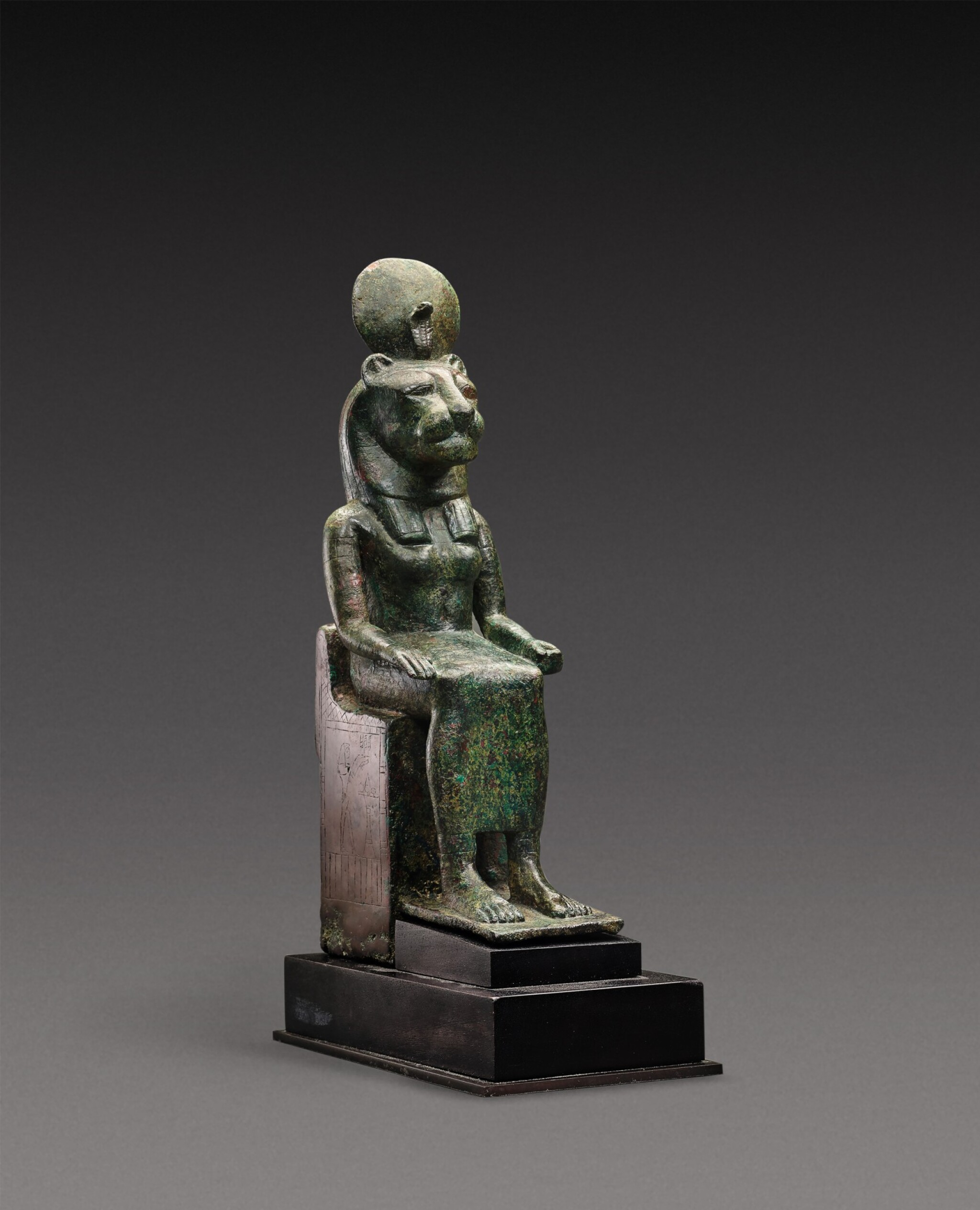 View 1 of Lot 38. An Egyptian Bronze Figure of a Lion-Headed Goddess, 26th Dynasty, 664-525 B.C..