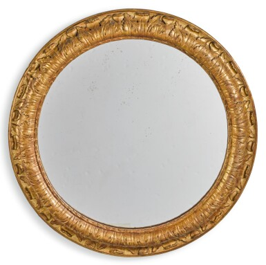 A CONTINENTAL CIRCULAR CARVED GILTWOOD WALL MIRROR 19TH CENTURY