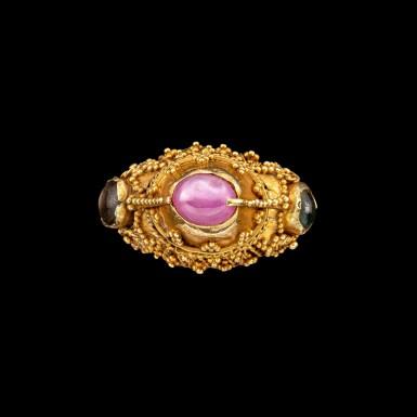 View 1. Thumbnail of Lot 1054. A gem-set gold priest's ring Bali, Indonesia, 19th - early 20th century   十九至二十世紀初 印尼峇里 金嵌寶戒指.