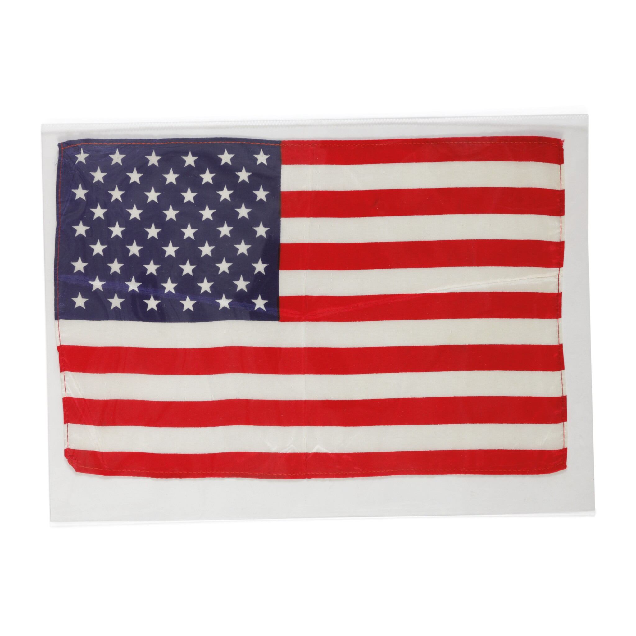 View full screen - View 1 of Lot 94. [APOLLO 10]. FLOWN ON APOLLO 10. LARGE UNITED STATES OF AMERICA FLAG FROM THE COLLECTION OF JOHN YOUNG.