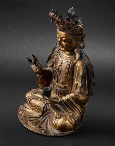 View 5. Thumbnail of Lot 39. Statue de Guanyin en bronze doré Dynastie Ming, XVIIE siècle | 明十七世紀 鎏金銅觀音菩薩坐像 | A large gilt-bronze figure of Guanyin on a lotus base, Ming Dynasty, 17th century.