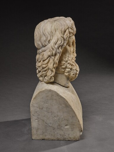 View 9. Thumbnail of Lot 32. A ROMAN MARBLE HEAD OF SARAPIS, CIRCA 2ND CENTURY A.D., ON 19TH CENTURY HERM SHOULDERS.
