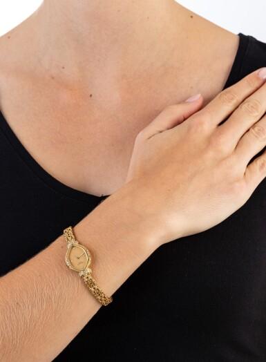View 4. Thumbnail of Lot 121. Patek Philippe | Montre bracelet de dame or et diamants | Lady's gold and diamond bracelet watch.