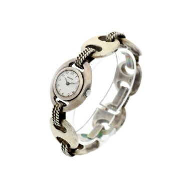 View 2. Thumbnail of Lot 238. RETAILED BY HERMES: A LADY'S STERLING SILVER BRACELET WATCH, CIRCA 1955.