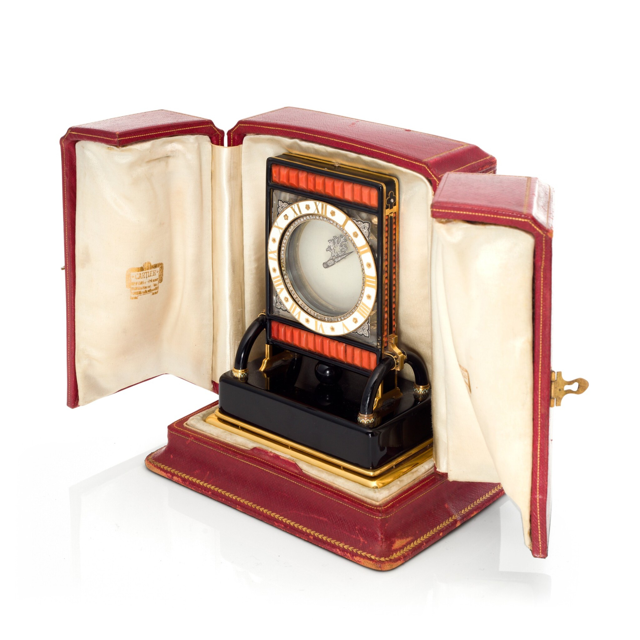 View full screen - View 1 of Lot 93. PENDULE ECRAN AN IMPORTANT AND RARE ROCK CRYSTAL, ONYX, ENAMEL, CORAL, YELLOW GOLD AND DIAMOND-SET MYSTERY DESK TIMEPIECE, CIRCA 1926.