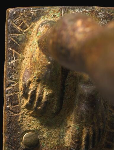 A GREEK BRONZE FIGURE OF A KOUROS DEDICATED TO APOLLO, LACONIAN, MID 6TH CENTURY B.C.