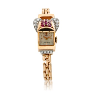 View 2. Thumbnail of Lot 163. A pink gold diamond and ruby-set concealed bracelet watch, Circa 1940.