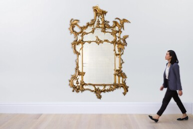 View 6. Thumbnail of Lot 164. A late George II carved giltwood wall mirror, after a design by Thomas Johnson, circa 1760.