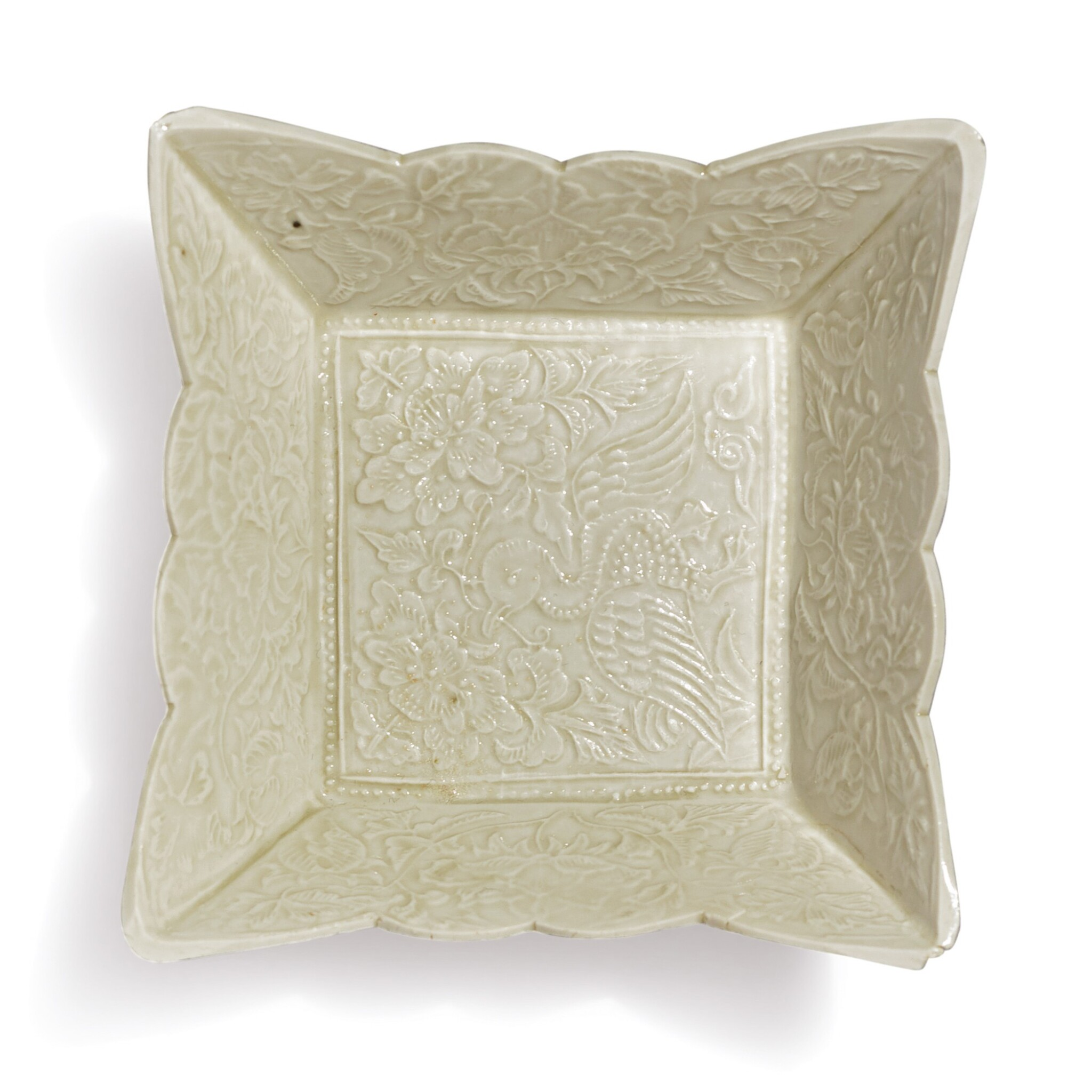 View 1 of Lot 697. A WHITE-GLAZED MOLDED 'DUCK' SQUARE DISH, LIAO DYNASTY.