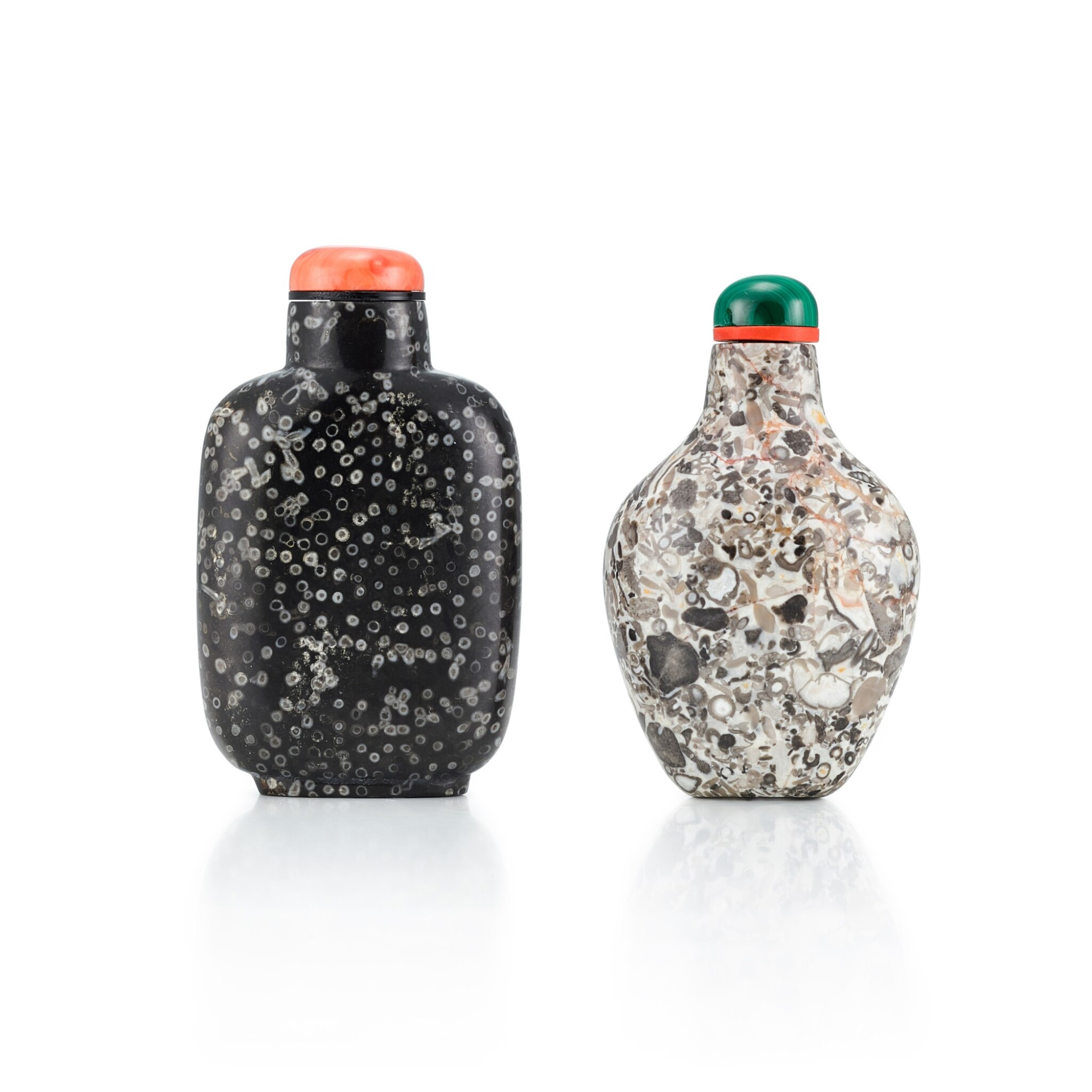 View full screen - View 1 of Lot 3043. Two Fossiliferous Limestone Snuff Bottles Qing Dynasty, 18th - 19th Century | 清十八至十九世紀 石化石灰石鼻煙壺兩件.