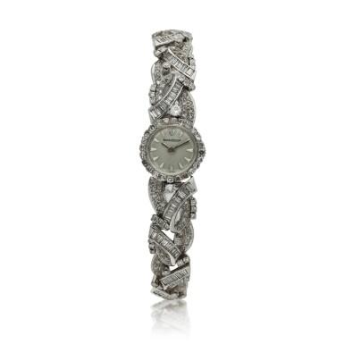 View 1. Thumbnail of Lot 160. A lady's white gold and diamond-set backwind wristwatch, Circa 1960.