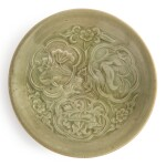 A rare small molded 'Yaozhou' celadon-glazed bowl, Northern Song / Jin dynasty | 北宋 / 金 耀州窰青釉印花鴛鴦花卉紋小笠式盌