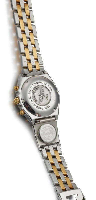 View 3. Thumbnail of Lot 8217. BREITLING | A STAINLESS STEEL AND YELLOW GOLD DUAL TIME ZONE CHRONOGRAPH WRISTWATCH WITH DATE AND BRACELET, CIRCA 2005.