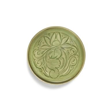 View 1. Thumbnail of Lot 95. A carved 'Yaozhou' celadon-glazed dish, Northern Song / Jin dynasty   北宋 / 金 耀州窰青釉刻蓮紋盤.