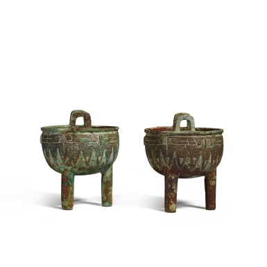 View 5. Thumbnail of Lot 1. An extremely rare pair of archaic bronze ritual food vessels (Ding), Late Shang dynasty   商末 子龔鼎一對.