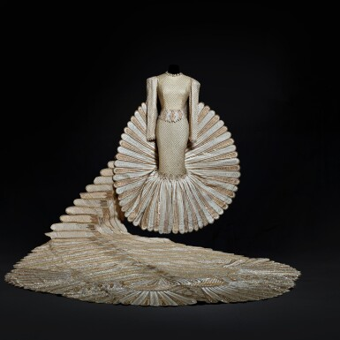 """View 1. Thumbnail of Lot 1. Haute Couture Full Length Dress with Extended Tail, Designed and Worn by Sherihan on the Television Show """"Alf Layla Wa Layla ('Thousand and One Nights')"""" in 1987. Executed in the Atelier by Adnan Akbar.."""
