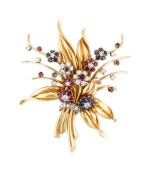 ROLEX | A YELLOW GOLD, DIAMOND, RUBY AND SAPPHIRE-SET BROOCH WITH TIMEPIECE, CIRCA 1960