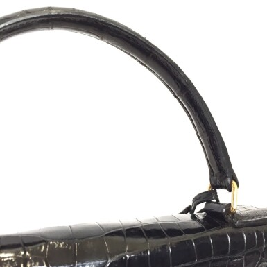 View 8. Thumbnail of Lot 743. HERMÈS | BLACK KELLY 28 IN SHINY CROCODILE WITH GOLD HARDWARE, 1962.
