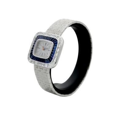 View 2. Thumbnail of Lot 98. REFERENCE 3655A6 A LADY'S WHITE GOLD BRACELET WATCH WITH DIAMOND AND SAPPHIRE-SET BEZEL, CIRCA 1970.