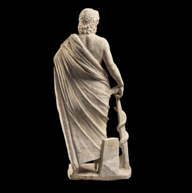 View 4. Thumbnail of Lot 232. A ROMAN MARBLE FIGURE OF ASKLEPIOS, CIRCA 2ND CENTURY A.D..
