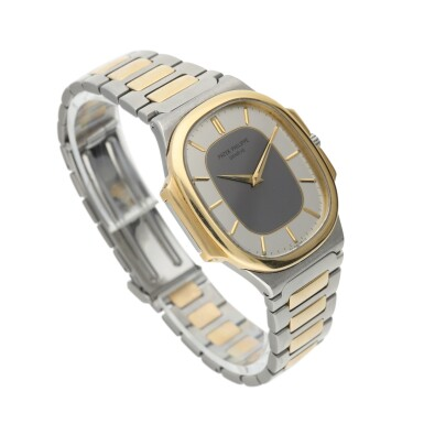 View 2. Thumbnail of Lot 134. PATEK PHILIPPE      REFERENCE 3770 'NAUTELLIPSE' A YELLOW GOLD AND STAINLESS STEEL OVAL FORM BRACELET WATCH, CIRCA 1982.