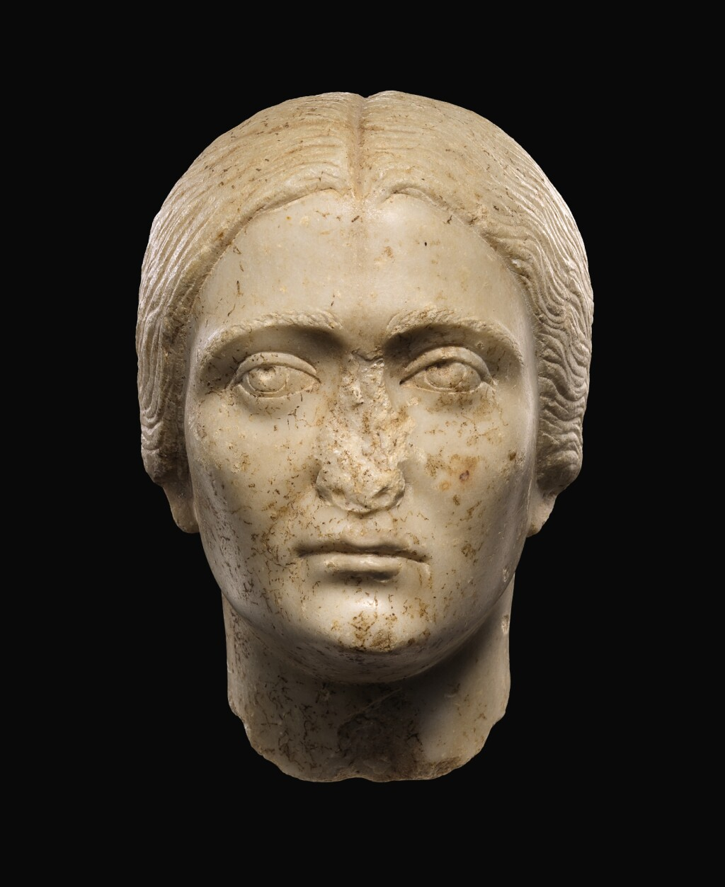 A ROMAN MARBLE PORTRAIT HEAD OF A WOMAN, ANTONINE, 3RD QUARTER OF THE 2ND CENTURY A.D.