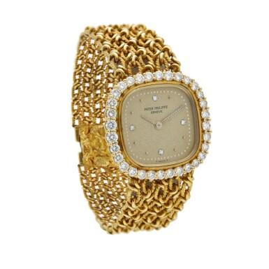 View 2. Thumbnail of Lot 99. Reference 4524/1  A yellow gold and diamond-set cushion shaped wristwatch, Circa 1982.