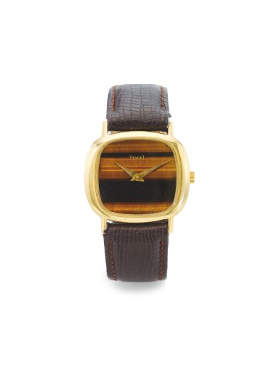 PIAGET | A YELLOW GOLD WRISTWATCH WITH TIGER'S EYE DIAL CIRCA 1975