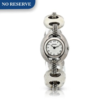 View 1. Thumbnail of Lot 238. RETAILED BY HERMES: A LADY'S STERLING SILVER BRACELET WATCH, CIRCA 1955.