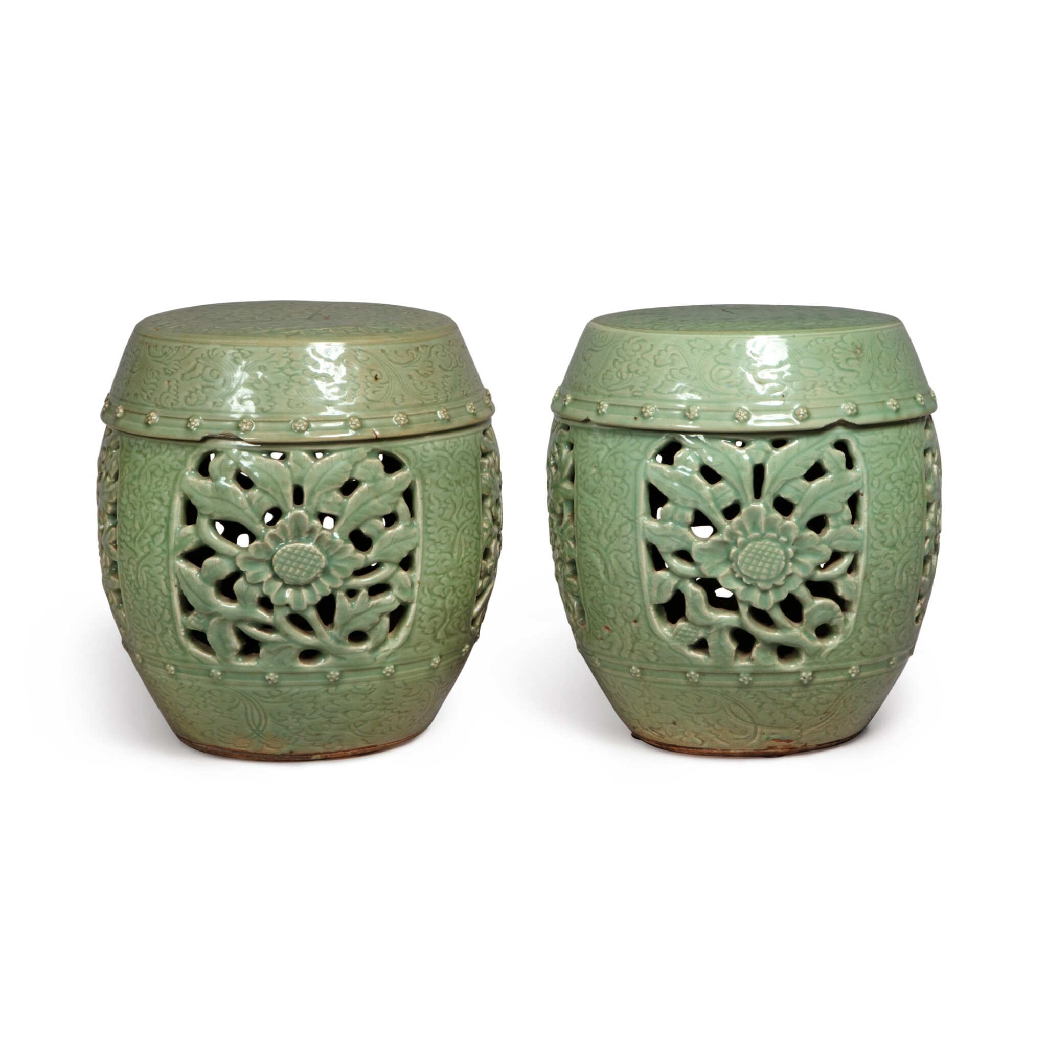 View full screen - View 1 of Lot 90. A pair of pierced and carved 'Longquan' celadon-glazed garden seats, Ming dynasty | 明 龍泉窰青釉開光鏤空花卉紋坐墩一對.