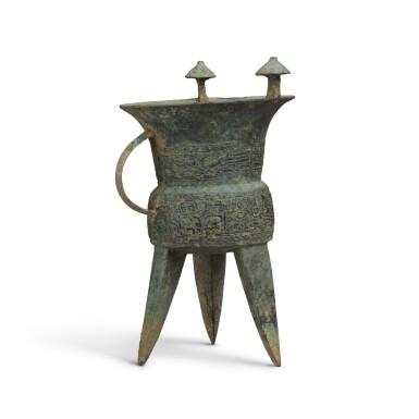 View 4. Thumbnail of Lot 4. An archaic bronze ritual wine vessel (Jia), Middle Shang dynasty   商中期 青銅饕餮紋斝.