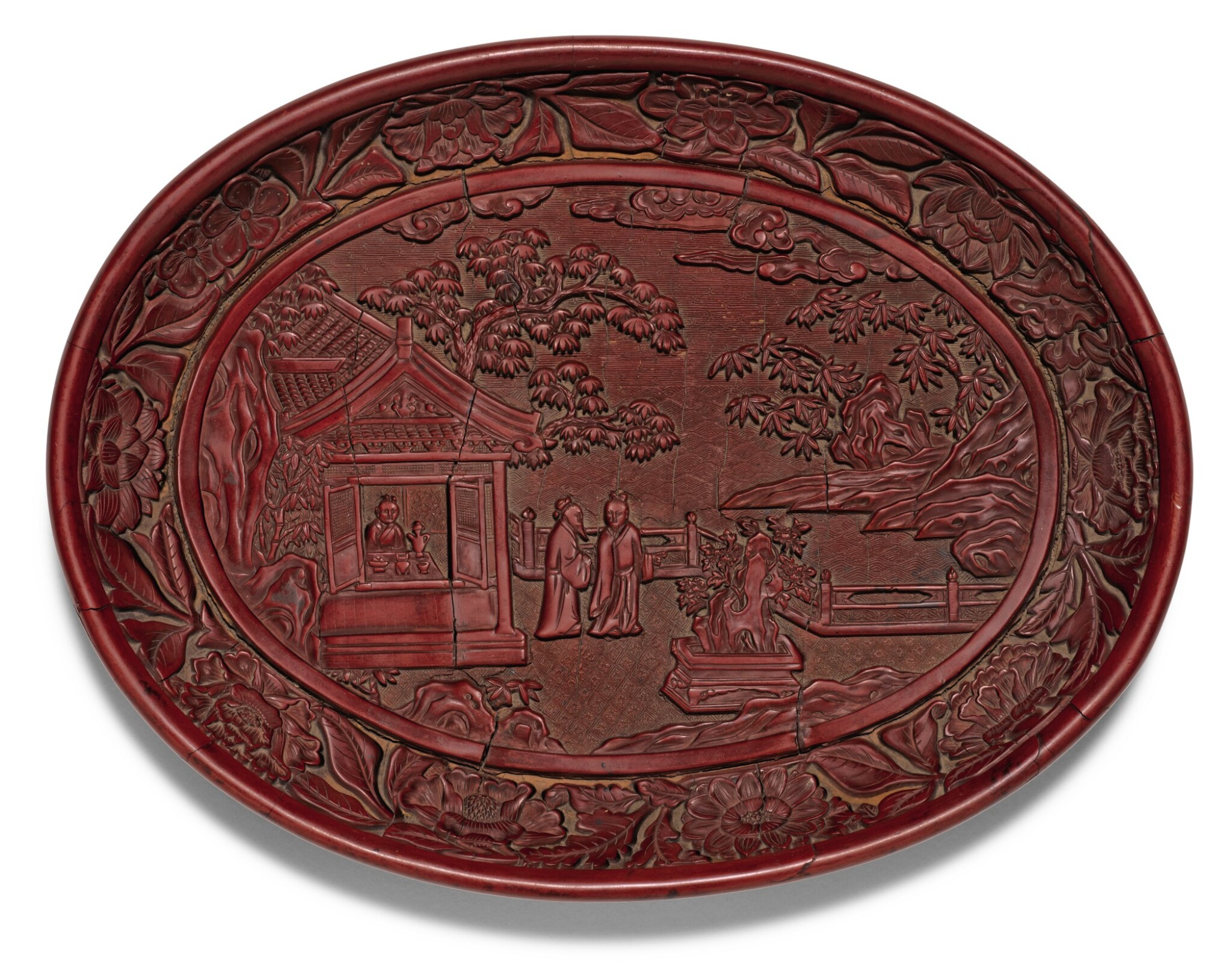 View 1 of Lot 139. A RARE AND FINELY CARVED CINNABAR LACQUER DISH YONGLE MARK AND PERIOD | 明永樂 剔紅賞石圖橢圓盤 《大明永樂年製》款.