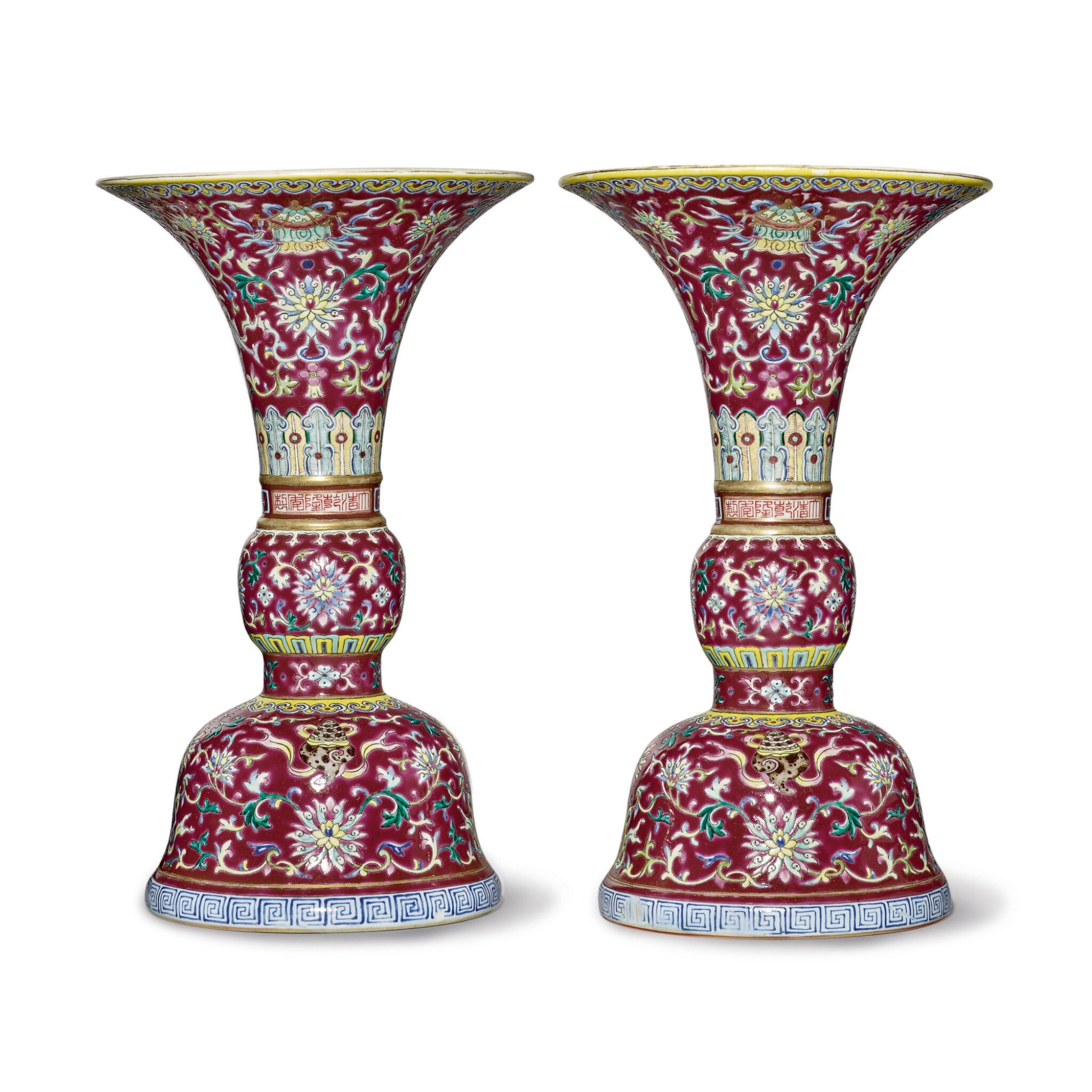 View 1 of Lot 539.  A PAIR OF RUBY-GROUND FAMILLE-ROSE 'BAJIXIANG' ALTAR VASES (GU),  QIANLONG SEAL MARKS AND PERIOD .